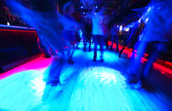 Legs of dancing people on dance floor Stock Photo