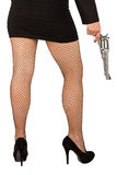 Legs of dangerous woman with handgun and black shoes Royalty Free Stock Images