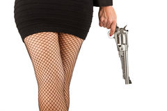 Legs of dangerous woman with handgun and black shoes Royalty Free Stock Photo