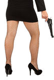 Legs of dangerous woman with handgun and black shoes Stock Photos