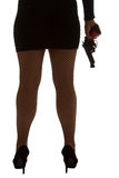 Legs of dangerous woman with handgun and black shoes silhouette Stock Images