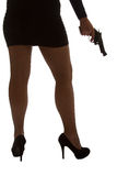 Legs of dangerous woman with handgun and black shoes silhouette Stock Image