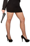 Legs of dangerous woman with handgun and black shoes Stock Images