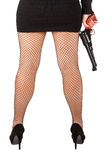 Legs of dangerous woman with handgun and black shoes Stock Image