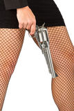 Legs of dangerous woman with handgun and black shoes Royalty Free Stock Photos