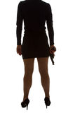 Legs of dangerous woman with handgun and black shoes Stock Photo