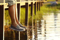 Legs dangling. Legs-dangling, Evening in natural stock image