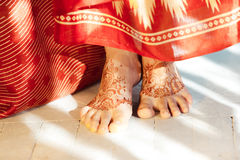 Legs decorated with indian mehandi painted henna. Indian picture on woman feet, mehendi tradition decoration, resistant design by special paint, brown henna Royalty Free Stock Image