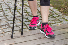 Legs of elderly senior woman and nordic walking sticks, sporty lifestyles Stock Image