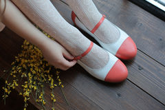 Legs in elegant shoes. Legs in elegant red shoes Royalty Free Stock Images