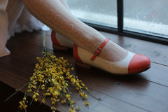 Legs in elegant shoes. Legs in elegant red shoes with flower Royalty Free Stock Photos