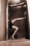 Legs in an  elevator Stock Images