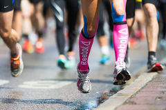 Legs and feet closup in ASICS Stockholm Marathon 2014 Royalty Free Stock Photos