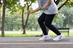 Legs and feet woman jogging in the park Stock Photo