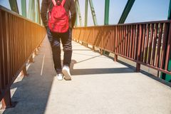 The Legs and feet,woman walking on bridge relax on tour. Legs and feet,woman walking on bridge relax on tour Royalty Free Stock Image