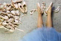 Legs of female dancer lying with pointe shoes loose Royalty Free Stock Photo