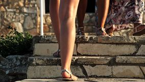 Legs female go up on stairs stock footage