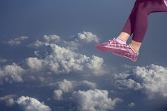 Legs of female over clouds. Close-up of legs of female over clouds enjoying summer Stock Photos