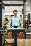 Legs femoral and quadriceps muscle training at pull. In gym Royalty Free Stock Images