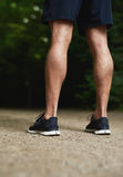 Legs of a fit muscular athletic man Royalty Free Stock Photos