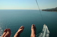 Legs in flight over the sea Stock Photo