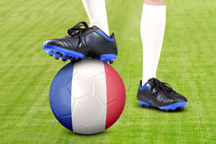 Legs of football player and ball Royalty Free Stock Image