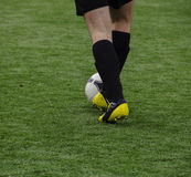 Legs football player with the ball. Legs football player with the sportive ball Royalty Free Stock Photography