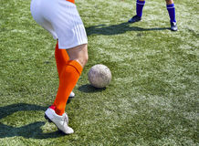 Legs of football players in action Royalty Free Stock Photo