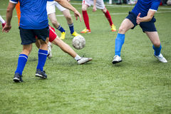 Legs of football players in action Royalty Free Stock Photos