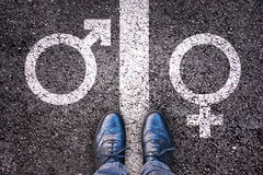 Legs with gender symbol on asphalt Stock Images