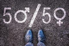 Legs with gender symbol on asphalt. Gender concept royalty free stock images