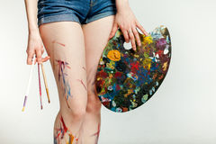 Legs girl artist Royalty Free Stock Photo