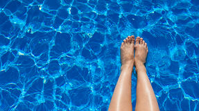 Legs girl on a background of pool water Stock Image