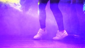 Legs of a girl dancing in the club. stock video