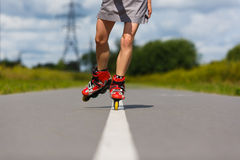 Legs of girl having roller skate exercise Royalty Free Stock Image
