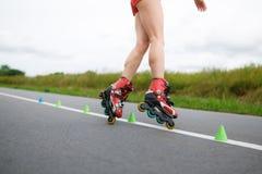 Legs of girl having roller skate exercise Stock Images