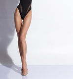 Legs of a girl i a swimsuit posing in studio Stock Photography