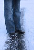 Winter background - legs of girl on the ice. Winter background - legs of a girl on the ice royalty free stock photography