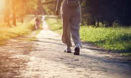 Legs of a girl, which goes along the path in the Park stock photo