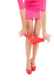 Legs of girl pulling panties Royalty Free Stock Photography