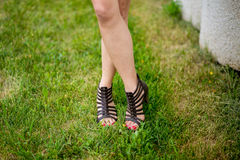 Legs of girl in sandals Royalty Free Stock Photo
