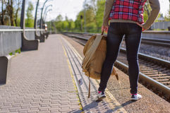 Legs of girl waiting train with backback Royalty Free Stock Photo