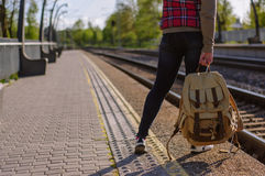 Legs of girl waiting train with backback Stock Photos