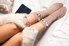 Legs of girl in warm woolen socks Stock Photos