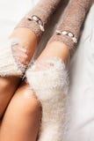Legs of girl in warm woolen socks Royalty Free Stock Photos