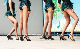 Legs of girls dancers Stock Photos