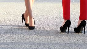 Two girls with heels. Legs of girls with heels are chilling around in athens exclusive desginers week stock footage