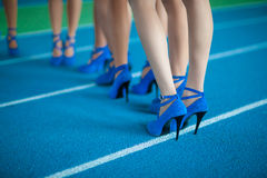 Legs of girls in high heel shoes. Stock Image