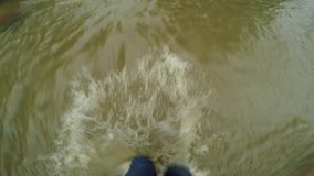 Legs go in troubled waters. Legs go on ankles in the water stock footage