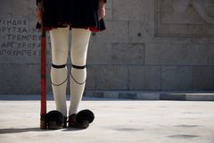 Legs of Greek presidential guardsman with rifle Royalty Free Stock Photos